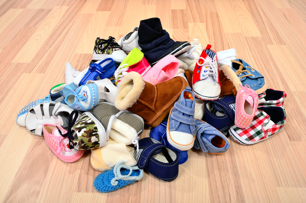Photo of big pile of baby shoes